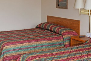 Iron Horse Inn - Motel & RV spaces :: Excellent value lodging year-round, w/covered access parking for cars & bikes. Close to Spearfish, Bear Butte Park and Sturgis. Dining & stores close by.