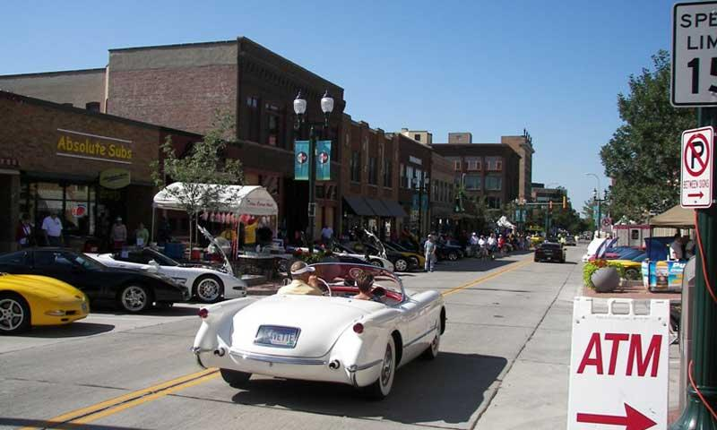 A Corvette rolls thorugh Main Street